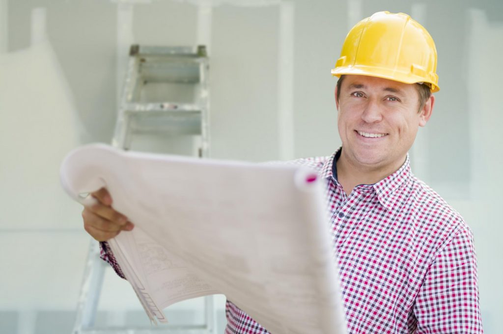 man holding a plan